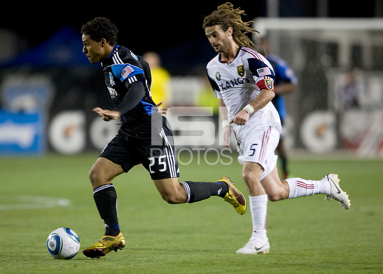 Quincy Amarikwa of Earthquakes dribbles the ball away from Kyle Beckerman of Real Salt Lake during the game at Buck Shaw Stadium in Santa Clara, California on March 27th, 2010.   Real Salt Lake defeated San Jose Earthquakes, 3-0.