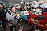Foreign domestic workers and their supporters demonstrate in the lobby of the Philippine consulate in Hong Kong in favor of Mary Jane Veloso, a Filipina overseas worker who was arrested and sentenced to death for smuggling heroin into Indonesia. She claims she was duped. Her case has sparked international attention towards Indonesia's capital punishment and drug prohibition laws, and the vulnerability of overseas workers.