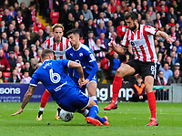 Lincoln City's Ollie Palmer has a shot blocked by Chesterfield's Ian Evatt<br /> <br /> Photographer Chris Vaughan/CameraSport<br /> <br /> The EFL Sky Bet League Two - Lincoln City v Chesterfield - Saturday 7th October 2017 - Sincil Bank - Lincoln<br /> <br /> World Copyright &copy; 2017 CameraSport. All rights reserved. 43 Linden Ave. Countesthorpe. Leicester. England. LE8 5PG - Tel: +44 (0) 116 277 4147 - admin@camerasport.com - www.camerasport.com