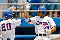 June 12, 2011:   Florida Gators inf/of Vickash Ramjit (30) celebrates with inf Cody Dent (20) at home plate after hitting a home run during NCAA Gainesville Super Regional Game 3 action between Florida Gators and Mississippi State Bulldogs played at Alfred A. McKethan Stadium on the campus of Florida University in Gainesville, Florida.  Florida defeated Mississippi State 8-6 to advance to the College World Series in Omaha, Nebraska........