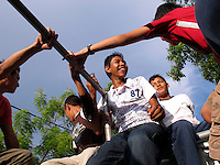 Members of the 'Music for Hope' project bands, Los Reyas and Los Sin Casa returning home on the back of a truck having performed at the 'Feria e intercambio de logros de campesinos y campesinas' in the village of Amando Lopez, El Salvador.