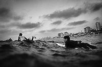 Surfing brothers, Mahmoud (21) and Yusef Alryashi (12) paddle into the Mediterranean Sea off Gaza City.