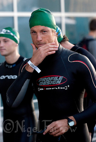02 AUG 2009 - LONDON, GBR - Formula 1 driver, Jenson Button waits for his wave start at the London Triathlon .(PHOTO (C) NIGEL FARROW)