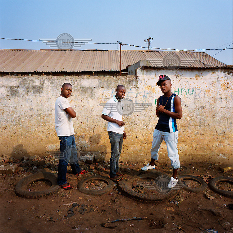 Aspirant Kuduru/Kuduro DJs in a street in Sambizanga Sambizanga musseque (slum). During the day they work as Candongueiro (communal taxi) drivers and in the evening they are recording music..
