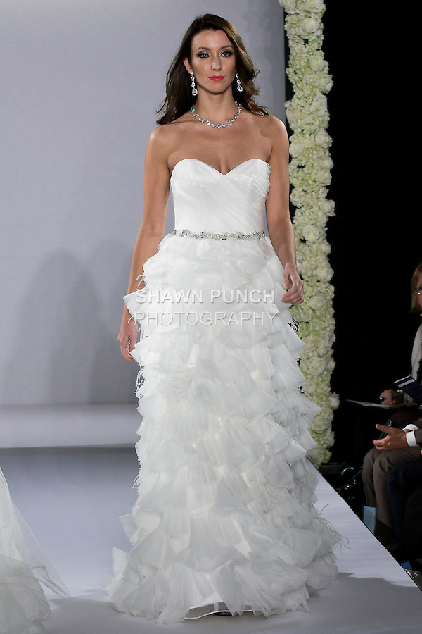 Model walks runway in a Jodi wedding dress from the Maggie Sottero Spring 2013 Bridal collection, for the Couture Runway Show, during New York Bridal Fashion Week at The Hilton Hotel, October 13, 2012.