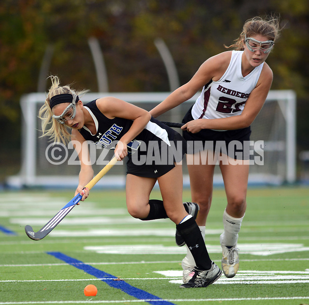 AMBLER, PA -  NOVEMBER 2:  Central Bucks South's Emily Cliggett (11) collides with West Chester Henderson's Haley Weaver (21) during the District One Class AAA field hockey championship game November 2, 2013 in Ambler, Pennsylvania. Central Bucks South lost to West Chester Henderson 1-0. (Photo by William Thomas Cain/Cain Images)