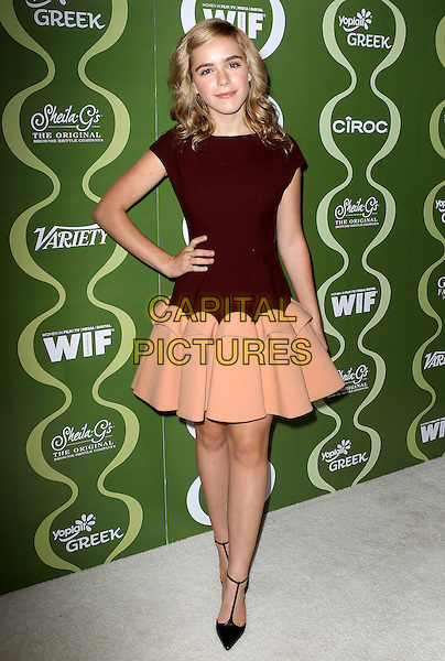 Kiernan Shipka<br /> Variety &amp; Women In Film Pre-Emmy Event presented by Yoplait Greek held at Scarpetta, Beverly Hills, California, USA, <br /> 20th September 2013.<br /> full length beige burgundy dress hand on hip maroon t-bar shoes pointy pointed peplum <br /> CAP/ADM/KB<br /> &copy;Kevan Brooks/AdMedia/Capital Pictures