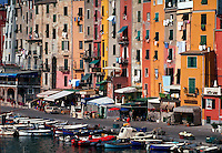Portovenere, Italy. Small shops, cafes, buildings and boats on the waterfront.