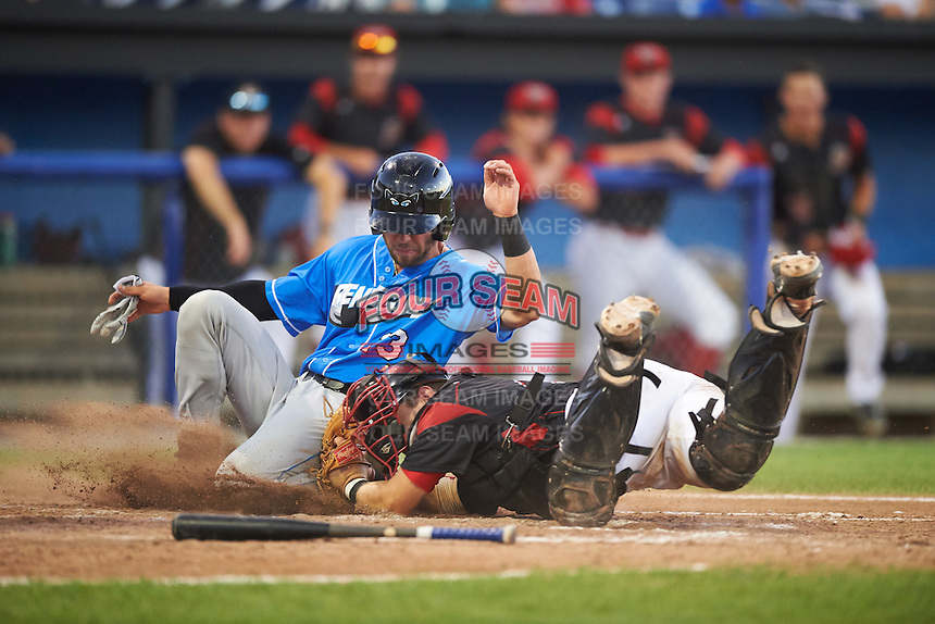 Hudson Valley Renegades Daniel De La Calle (13) is tagged out by catcher Jarett Rindfleisch (44) while sliding into home during a game against the Batavia Muckdogs on August 2, 2016 at Dwyer Stadium in Batavia, New York.  Batavia defeated Hudson Valley 2-1.  (Mike Janes/Four Seam Images)