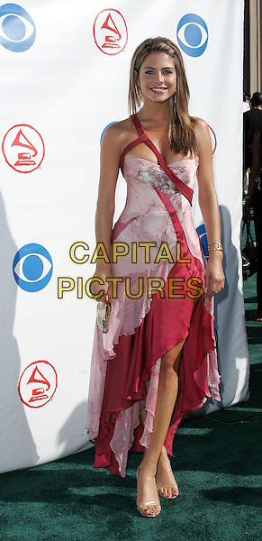 MARIA MENOUNOS.The 5th Annual Latin Grammy Awards held at The Shrine Auditoreum in Los Angeles, California.September 1st, 2004.full length, pink and red, layered, layers, ruffled, ruffles, straps.www.capitalpictures.com.sales@capitalpictures.com.Copyright by Debbie VanStory