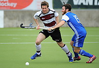 Johnny Kinder tries to slow Matt Symonds during the 2017 National Hockey League Men's final between Auckland and North Harbour at National Hockey Stadium in Wellington, New Zealand on Sunday, 24 September 2017. Photo: Dave Lintott / lintottphoto.co.nz