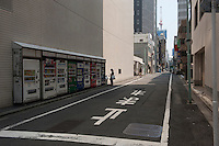 Daytime landscape view of a woman in front of a vending machine near Tokyo Eki following the 311 Tohoku Tsunami in Tokyo, Japan  © LAN
