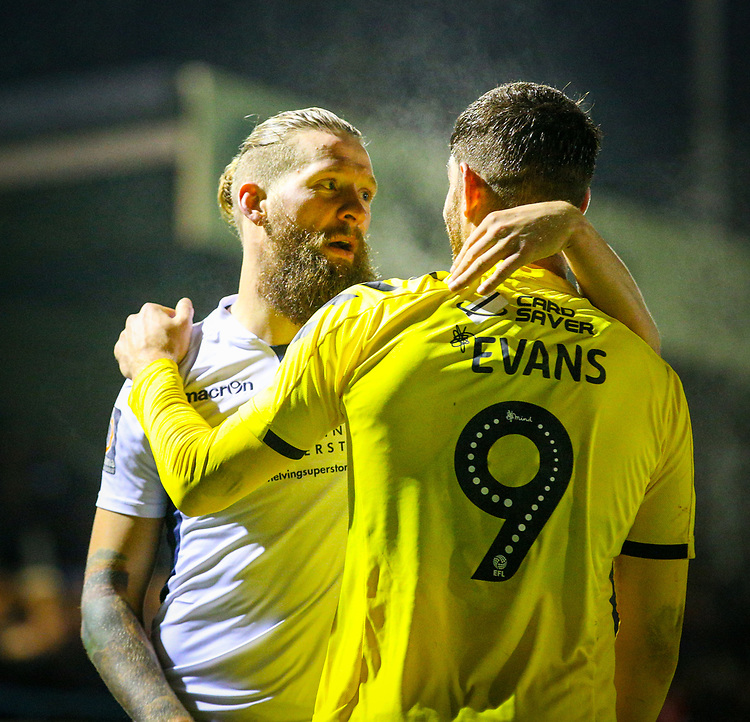 Guiseley's Kingsley James embraces Fleetwood Town's Ched Evans after the game<br /> <br /> Photographer Alex Dodd/CameraSport<br /> <br /> The Emirates FA Cup Second Round - Guiseley v Fleetwood Town - Monday 3rd December 2018 - Nethermoor Park - Guiseley<br />  <br /> World Copyright &copy; 2018 CameraSport. All rights reserved. 43 Linden Ave. Countesthorpe. Leicester. England. LE8 5PG - Tel: +44 (0) 116 277 4147 - admin@camerasport.com - www.camerasport.com
