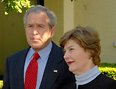 Washington, D.C. - May 6, 2007 -- United States President George W. Bush makes a statement on the devastating overnight tornados in Kansas as he and first lady Laura Bush depart St. John's Church following Sunday services in Washington, D.C. on Sunday, May 6, 2007.  <br /> Credit: Ron Sachs - Pool via CNP