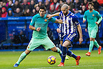 FC Barcelona's forward Luis Suarez competes for the ball with Club Deportivo Alaves'es defender Victor Laguardia Cisneros  during the match of La Liga between Deportivo Alaves and Futbol Club Barcelona at Mendizorroza Stadium in Vitoria, Spain. February 11, 2017. (ALTERPHOTOS/Rodrigo Jimenez)