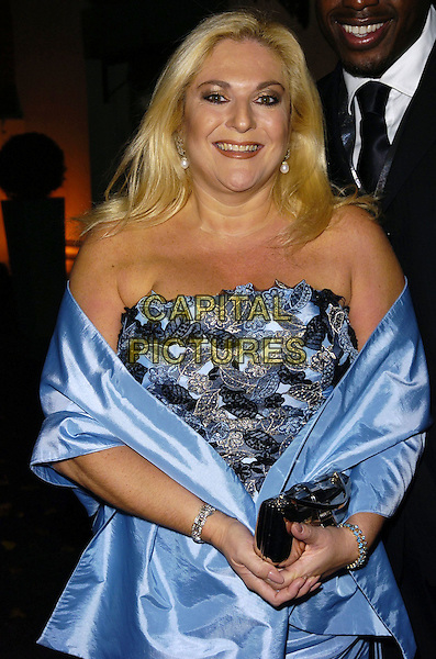 VANESSA FELTZ .At The Halloween Ball, Mariott Grosvenor Square Hotel, London, England, October 28th 2006..Half length blue strapless dress wrap shawl top skirt.Ref: CAN.www.capitalpictures.com.sales@capitalpictures.com.©Can Nguyen/Capital Pictures