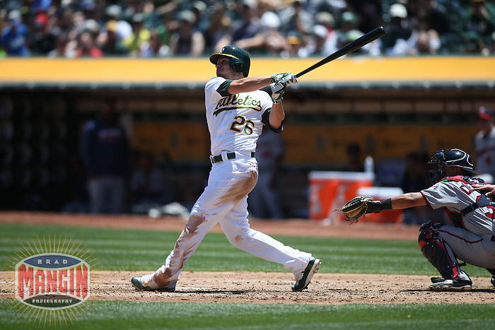 OAKLAND, CA - JUNE 1:  Danny Valencia #26 of the Oakland Athletics bats against the Minnesota Twins during the game at the Oakland Coliseum on Wednesday, June 1, 2016 in Oakland, California. Photo by Brad Mangin