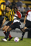 20 March 2004: Freddy Adu (9) scores his first professional goal as Teddy Chronopoulos (left) watches in the 56th minute to give DC United a 1-0 lead. DC United defeated Charleston Battery 2-1 at Blackbaud Stadium in Charleston, SC in a Carolina Challenge Cup match...