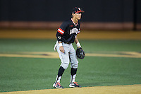 Davidson Wildcats shortstop Max Bazin (21) on defense against the Wake Forest Demon Deacons at David F. Couch Ballpark on February 28, 2017 in Winston-Salem, North Carolina.  The Demon Deacons defeated the Wildcats 13-5.  (Brian Westerholt/Four Seam Images)