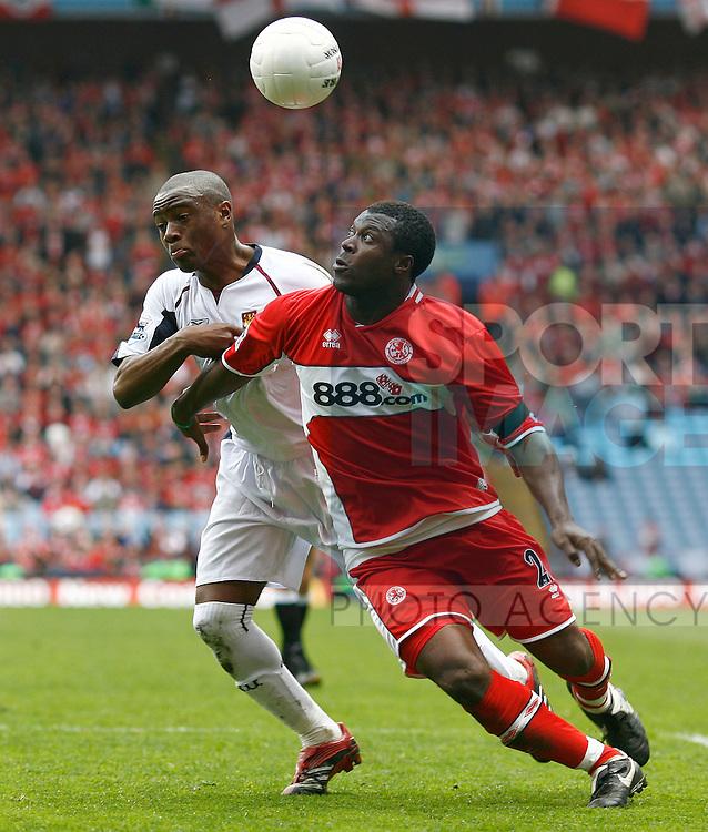Middlesborough's Yakubu Ayegbeni and West Ham's Nigel Reo Coker.