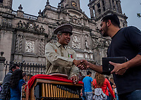 Oscar Rosas Jardines, 20, plays a harmonipan for tips, in Centro Historico on August 24, 2016 in Mexico City, Mexico. <br /> Photo Daniel Berehulak for The New York Times