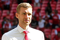 Per Mertesacker of Arsenal who suffered a nasty cut to his face and was substituted in the first half returns to the pitch after the game to join in the celebrations during Arsenal vs Chelsea, FA Community Shield Football at Wembley Stadium on 6th August 2017