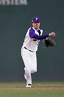 Shortstop Brett Huebner (3) of the Furman Paladins throws out a runner in a game against the South Carolina Gamecocks on Tuesday, March 19, 2019, at Fluor Field at the West End in Greenville, South Carolina. South Carolina won, 12-7. (Tom Priddy/Four Seam Images)