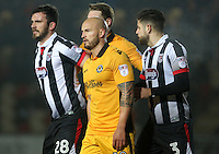 Gavin Gunning, David Pipe of Newport County and Danny Andrew of Grimsby Town during the Sky Bet League Two match between Newport County and Grimsby Town at Rodney Parade, Newport, Wales, UK. Tuesday 14 February 2017