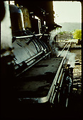 View down side of engine boiler to track ahead with Coaling tower to left.<br /> D&amp;RGW  Durango ?, CO