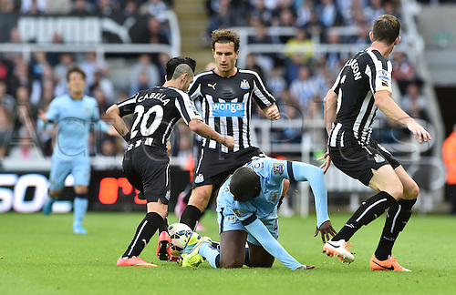 17.08.2014.  Newcastle upon Tyne, England. Premier League. Newcastle United versus Manchester City. Newcastle midfielder Remy Cabella (20) takes the ball from Manchester city midfielder Yaya Toure