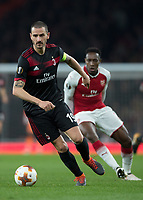 Leonardo Bonucci of AC Milan in action as Danny Welbeck of Arsenal looks on during the UEFA Europa League round of 16 2nd leg match between Arsenal and AC Milan at the Emirates Stadium, London, England on 15 March 2018. Photo by Vince  Mignott / PRiME Media Images.