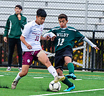 WATERBURY,  CT-101619JS23-  Sacred Heart's Bill Nguyen (10) and Wilby's Nilton Miguel (11) fight for the ball during their NVL game Thursday at Municipal Stadium in Waterbury. <br />  Jim Shannon Republican-American
