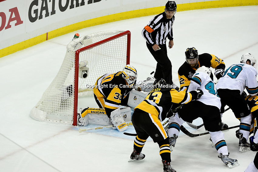 Wednesday, June 1, 2016: Players pile in front of Pittsburgh Penguins goalie Matt Murray (30) as the puck flies in the air during game 2 of the NHL Stanley Cup Finals  between the San Jose Sharks and the Pittsburgh Penguins held at the CONSOL Energy Center in Pittsburgh Pennsylvania. The Penguins beat the Sharks in overtime 2-1 and lead the best of 7 series 2-0. Eric Canha/CSM