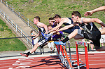 Runners clear the first set of hurdles in the 100 hurdles.