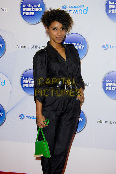 Lianne La Havas<br /> Barclaycard Mercury Prize Nominations at the Hospital, Endell Street.<br /> Where: London, England.<br /> 11th September 2013<br /> half length jumpsuit black hand in pocket black green handbag purse bag <br /> CAP/CJ<br /> &copy;Chris Joseph/Capital Pictures