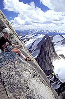 Climber climbing near summit of Bugaboo Spire, Bugaboo Glacier Provincial Park, British Columbia, Canada