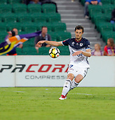 25th March 2018, nib Stadium, Perth, Australia; A League football, Perth Glory versus Melbourne Victory; James Donachie of Melbourne Victory crosses the ball into the box as Perth Glorys Joseph Mills watches on