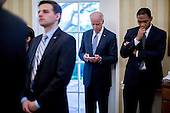 """United States Vice President Joseph """"Joe"""" Biden, center, attends a bilateral meeting between U.S. President Barack Obama, and President Jose Mujica Cordano of Uruguay, not pictured, in the Oval Office of the White House in Washington, D.C., U.S., on Monday, May 12, 2014.The leaders discussed ways to grow bilateral economic ties and expand collaboration on science, technology, and health.  <br /> Credit: Andrew Harrer / Pool via CNP"""