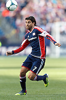 New England Revolution forward Juan Toja (7) collects a pass. .  In a Major League Soccer (MLS) match, FC Dallas (red) defeated the New England Revolution (blue), 1-0, at Gillette Stadium on March 30, 2013.