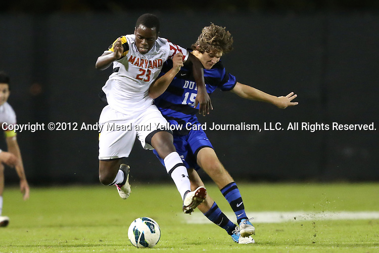 12 October 2012: Duke's Zach Mathers (15) tries to knock Maryland's Schillo Tshuma (ZIM) (23) off of the ball. The University of Maryland Terrapins defeated the Duke University Blue Devils 2-1 at Koskinen Stadium in Durham, North Carolina in a 2012 NCAA Division I Men's Soccer game.