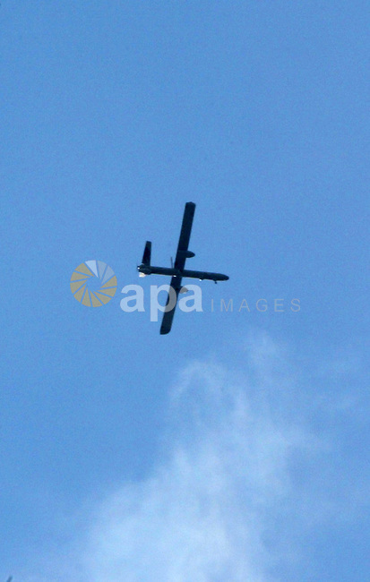 An Israeli drone is seen over Rafah town in the southern Gaza Strip on Oct. 30, 2011. An Egyptian-brokered truce failed to take hold on Sunday to halt violence between Israel and Gaza militants in which nine Palestinian gunmen and an Israeli civilian have been killed.i. Photo by Abed Rahim Khatib