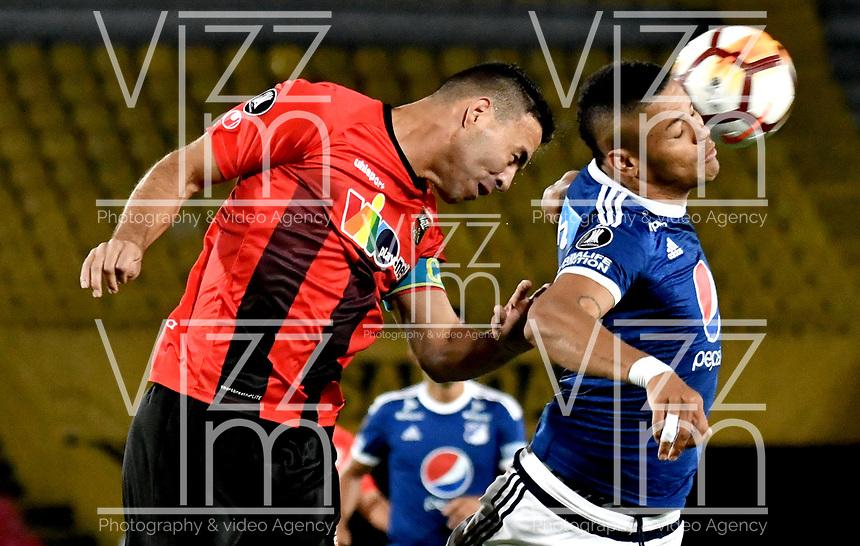 BOGOTA - COLOMBIA – 17 - 04 - 2018: Ayron del Valle (Der.) jugador de Millonarios (COL), salta por el balon con Henri Pernia (Izq.) jugador de Deportivo Lara (VEN), durante partido entre Millonarios (COL) y Deportivo Lara (VEN), durante partido entre Millonarios (COL) y Deportivo Lara (VEN), de la fase de grupos, grupo G, fecha 3 de la Copa Conmebol Libertadores 2018, en el estadio Nemesio Camacho El Campin, de la ciudad de Bogota. / Ayron del Valle (R) player of Millonarios (COL), jumps for the ball with Henri Pernia (L) player of Deportivo Lara (VEN), during a match between Millonarios (COL) and Deportivo Lara (VEN), of the group stage, group G, 3rd date for the Conmebol Copa Libertadores 2018 in the Nemesio Camacho El Campin stadium in Bogota city. VizzorImage / Luis Ramirez / Staff.