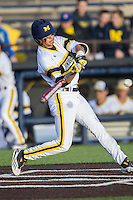 Michigan Wolverines second baseman Hector Gutierrez (24) swings the bat against the Central Michigan Chippewas on March 29, 2016 at Ray Fisher Stadium in Ann Arbor, Michigan. Michigan defeated Central Michigan 9-7. (Andrew Woolley/Four Seam Images)