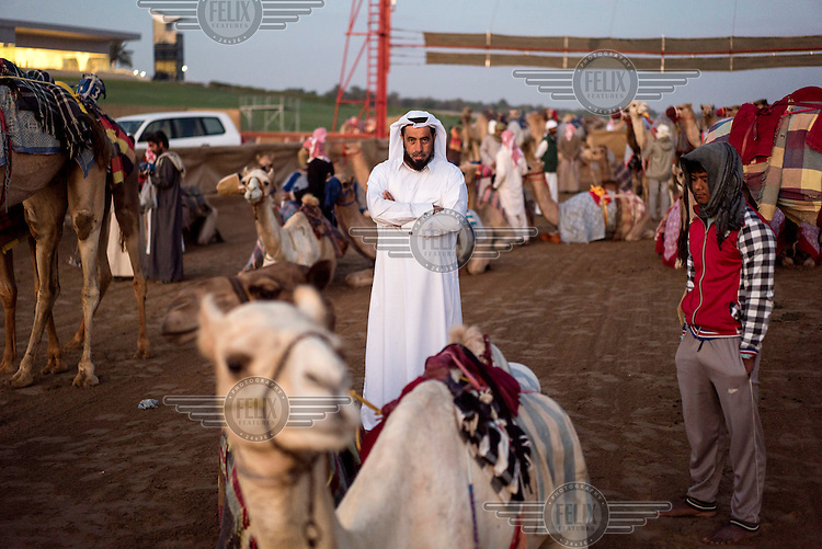 A camel owner at the Abu Dhabi racetrack.