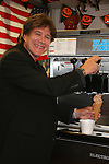 Frank Dicopoulos & ice cream cone - Guiding Light's actors meet fans at Stacy Jo's Ice Cream in McKees Rocks, PA on September 30, 2009. During the weekend of events proceeds from pink ribbon bagel sales at various Panera Bread locations will benefit the Young Women's Breast Cancer Awareness Foundation. (Photo by Sue Coflin/Max Photos)
