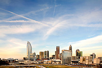 After many years of construction, the Charlotte skyline is complete (at least until the next high rise is announced). Photo taken December 2010. Multiple photos were taken on this date and from this angle (and other angles) as the sun was setting. Photo shows new Duke Energy Center (tall building far left) and NASCAR Hall of Fame (center/right).