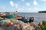 Fisherman on a jetty with nets at Sainte Anne late afternoon