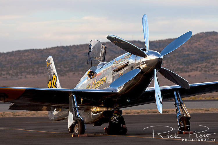 A Precious Metal crew member tends to the P-51 Mustang Unlimited Air Racer during the 2012 Reno National Championship Air Races