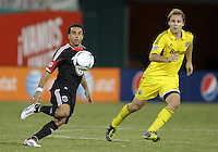 WASHINGTON, DC - AUGUST 4, 2012:  Dwayne DeRosario (7) of DC United receives a pass in front of Chad Marshall (14) of the Columbus Crew during an MLS match at RFK Stadium in Washington DC on August 4. United won 1-0.