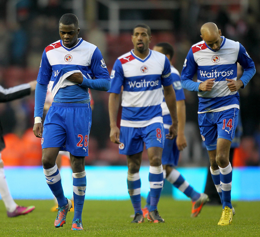 Reading's players leave the pitch looking dejected..Football - Barclays Premiership - Stoke City v Reading - Saturday 9th February 2013 - Britannia Stadium - Stoke..